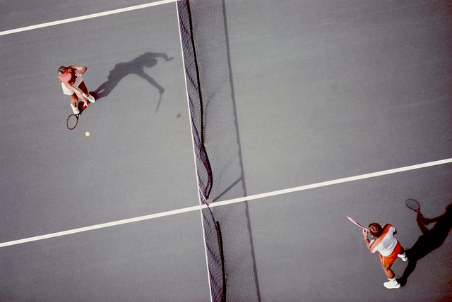two players playing tennis near the net