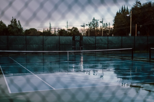 how much does it take for a tennis court to dry