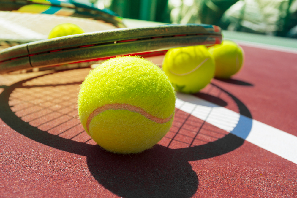 Tennis equipment on the court