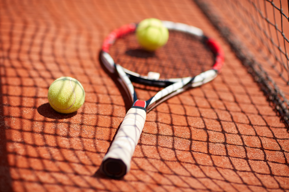 tennis racket on the clay court