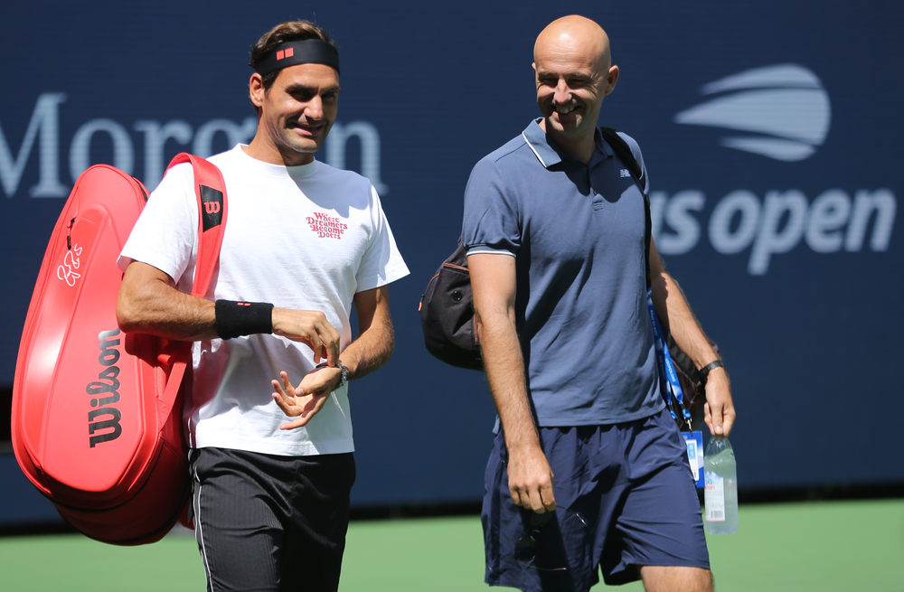 Roger Federer with his coach
