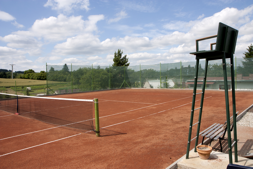 Tennis court with umpire chair