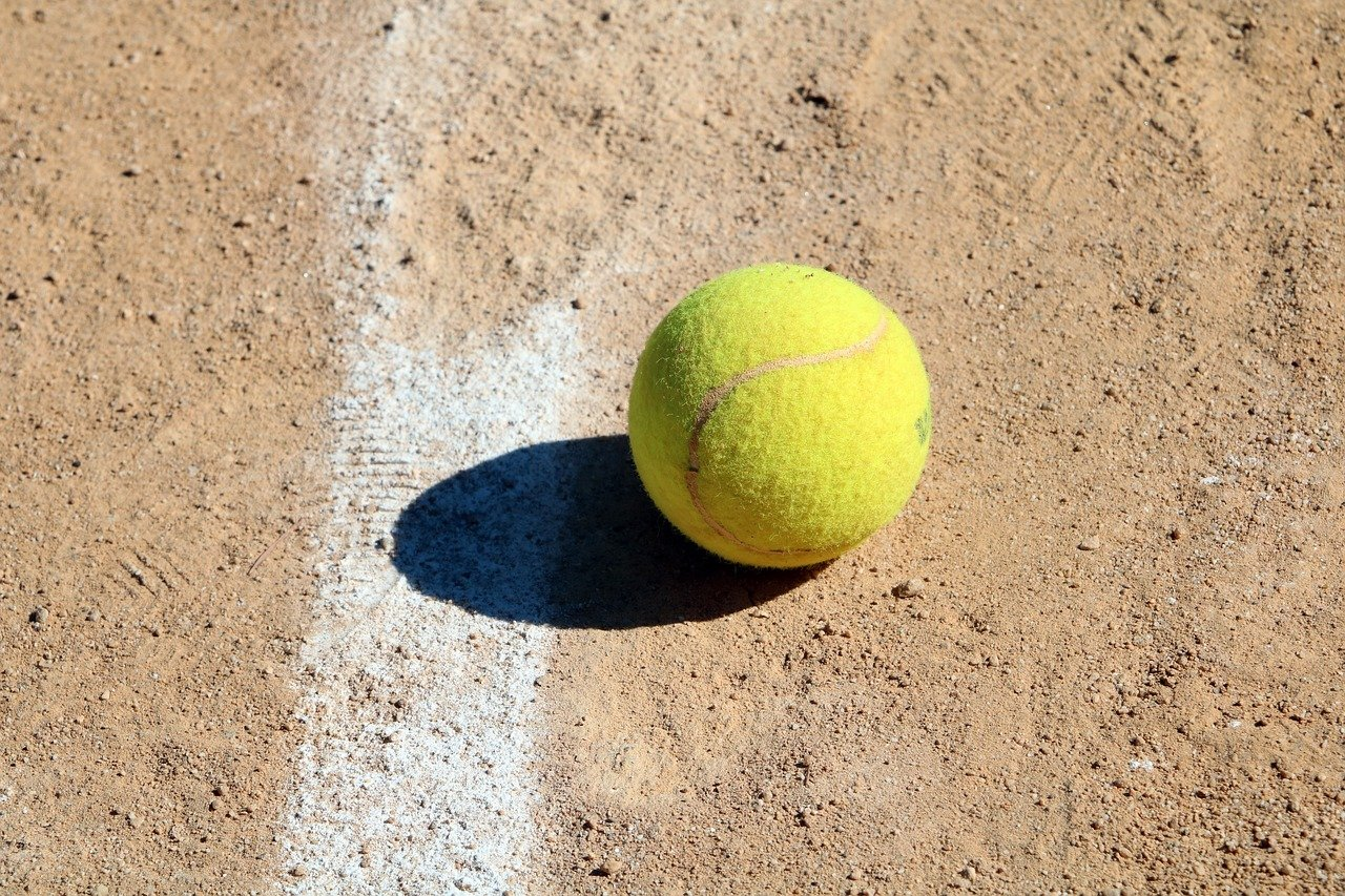 tennis ball on the clay